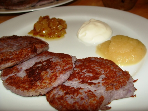 Purple Potato Pancakes with caramelized onions, strained yogurt and applesauce